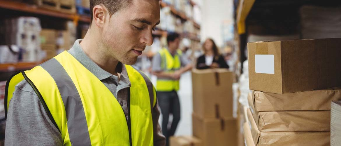 bigstock-Warehouse-worker-scanning-box-121244318-1.jpg